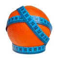 Big orange wrapped with blue measurement tape. Royalty Free Stock Images