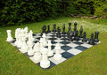 Big outdoor chess in green lawn Stock Photo