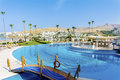 Big Outdoor Pool With Palms An...