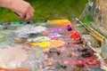 Big painter's palette with fresh paint outdoors Royalty Free Stock Photo