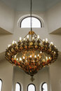 Big pending lamp solid gold in a church Royalty Free Stock Photo