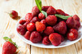 Big plate of strawberries without tails close up food Stock Photos