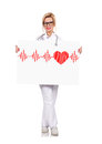 Big poster with heartbeat young female doctor holding Royalty Free Stock Image