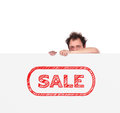 Big poster with sale unhappy man holding Royalty Free Stock Photos
