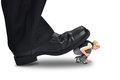 Big power boss stepping on little employee a corporate foot is a small woman for a or management concept Stock Photography