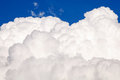 Big puffy cloud white on the blue sky Stock Images