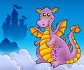 Big purple dragon with castle Stock Images
