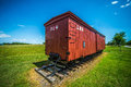 Big red caboose wagon with blue skies Royalty Free Stock Photos