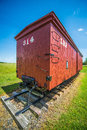 Big red caboose wagon on sunny day Stock Photos