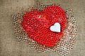 Big red heart,small white heart and many tiny glass marble Royalty Free Stock Photo