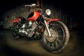 Big red motorcycle in dark garage Royalty Free Stock Images