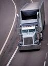 Big rig classic traditional custom design semi truck gray chrome Royalty Free Stock Photo