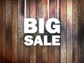 Big sale text on wooden background eps Stock Photography
