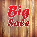 Big sale text on wooden wall.