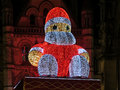 Big santa claus albert square manchester illuminated on town hall overlooking during the festive season of the xmas markets Stock Photo
