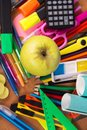 Big set of bright office supply a and an apple closeup Stock Photo