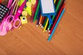 Big set of school tools on wood office a color pencils and empty badge a table Stock Image