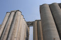 Big silos for corn and wheat group of industrial concrete grain Royalty Free Stock Photo