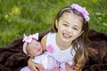 Big sis smiles two young sisters in adorable matching outfits outside Stock Photography