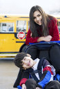 Big sister with disabled brother at school Stock Photo