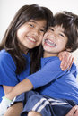 Big sister holding disabled brother Royalty Free Stock Photo