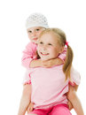 Big sister, little sister hugging Royalty Free Stock Photo