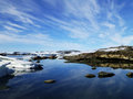 Big sky and ice antarctica a stunning panorama on the waters edge of newcomb bay Royalty Free Stock Image