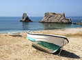 Big and small boats on the seashore against rocks Royalty Free Stock Photography