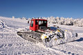 Big snowplow at the ski slope Royalty Free Stock Image