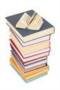 Big stack of books and opened small book Stock Images