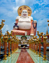 Big statue of smiling buddha thailand koh samui at buddhist pagoda part temple complex wat plai laem on island Royalty Free Stock Photo