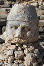 Big stone head on the mount nemrud in turkey Royalty Free Stock Image