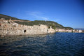 Big stone wall in the sea Royalty Free Stock Images