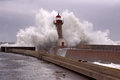 Big stormy wave against pier and old lighthouse foz do douro harbor Royalty Free Stock Photo