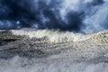 Big stormy wave waves crashing over portuguese coast enhanced sky Stock Photography
