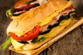 Big submarine sandwich selective focus on the front with cheese and ham Royalty Free Stock Photography