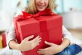 Big surprise close up of girl holding red giftbox Stock Photography