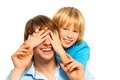 Big surprise young happy smiling father guesses who with his son cover face with palms Stock Images