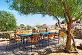 Big table under tree in outdoor restaurant shot namibia Royalty Free Stock Photo