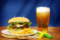 Big tasty burger close up of french fries and beer Stock Photography