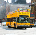 Big taxi tours tourists taking a ride with an hop on hop off bus in nyc Stock Photo