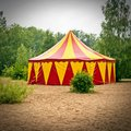 Big top red and yellow in a sandy park with trees germany Stock Images