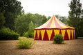 Big top red and yellow in a sandy park with trees germany Stock Photography