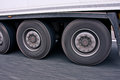 Big truck wheels in motion view of the two of an wheeler showing during highway driving Royalty Free Stock Photo