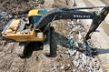 Big volvo excavator on construction site forward activity the river bed Royalty Free Stock Photo