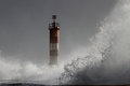 Big wave against beacon splashing pier and focus on the north of portugal Stock Images