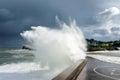 Big wave breaking on breakwater Royalty Free Stock Photo