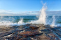 Big wave on lake superior crashes against a rocky shoreline pictured rocks national lakeshore in the upper peninsula of michigan Stock Photo