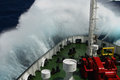 Big wave rolling over the snout of the ship photo Stock Photography