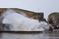 Big waves at castro urdiales port Royalty Free Stock Images